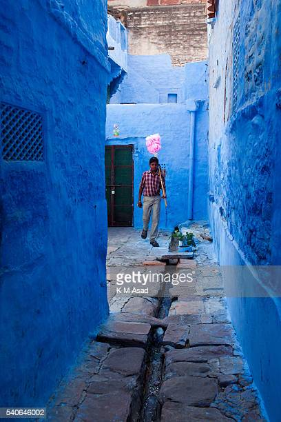 A boy sells sweets in Jodhpur Rajasthan India December 05 2013 This city was founded in 1459 People continue to paint their houses blue as they say...
