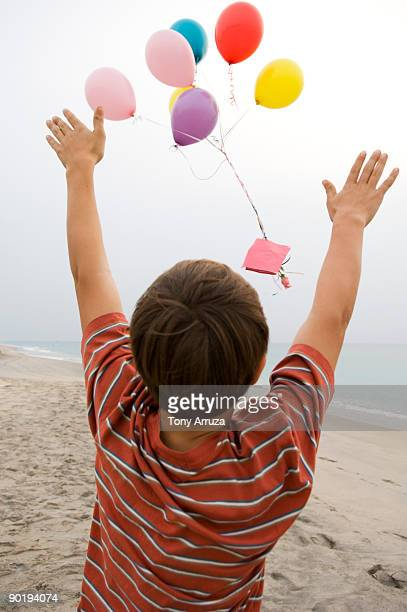 boy sending mom his love - mothers day beach stock pictures, royalty-free photos & images