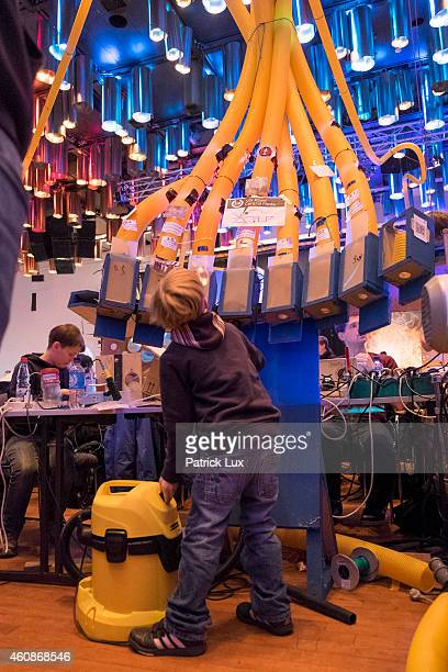 A boy sends a pneumatic post powered by a vacuum at the 31st annual Chaos Communication Congress on December 28 2014 in Hamburg Germany The annual...