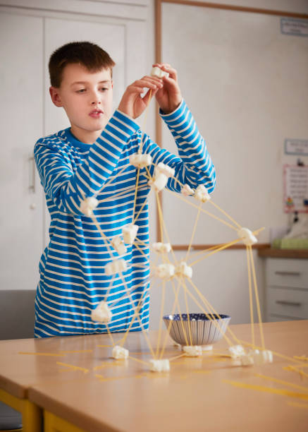Boy setting up construction during a science lesson