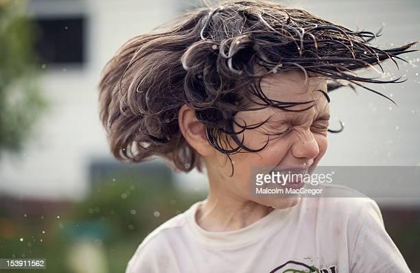 Boy shaking wet head