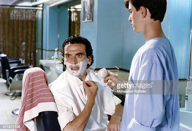 A boy shaving Italian actor and director Massimo Troisi in the film Pensavo fosse amore invece era un calesse 1991