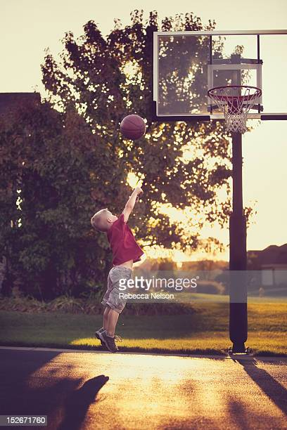 boy shooting a layup - shooting baskets stock pictures, royalty-free photos & images
