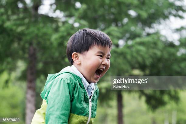 boy shouting and playing in the nature - only japanese stock pictures, royalty-free photos & images