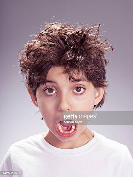 boy shouting with messy hair acting mischievous