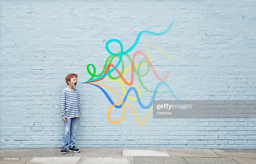Boy shouting with sound waves : Stock Photo