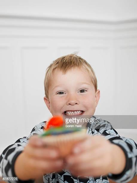 Boy Showing Cupcake