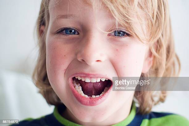 boy showing lost tooth, portrait - losing virginity stock pictures, royalty-free photos & images