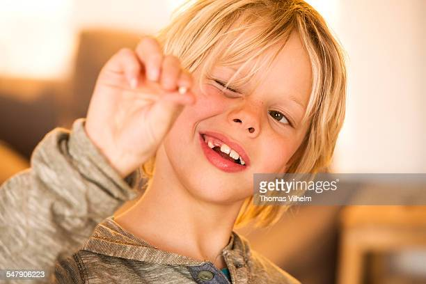 Boy showing missing milk tooth