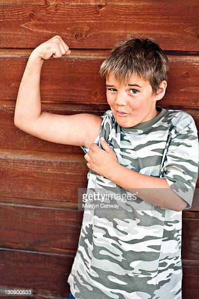 Boy showing off his bicep muscle
