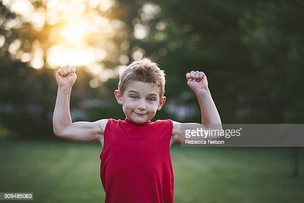 Boy showing off his muscles