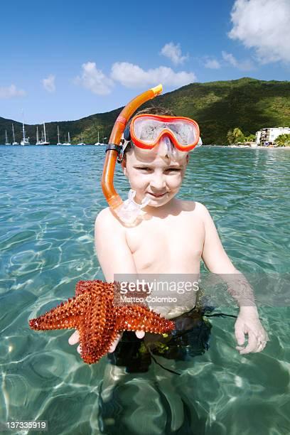Boy showing starfish