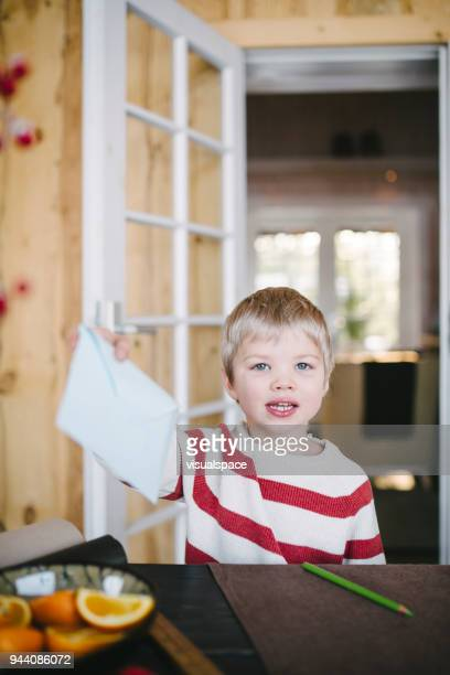 Boy shows his letter to Santa Claus