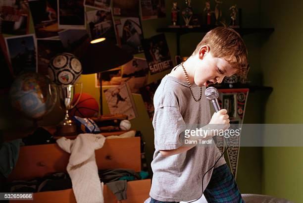 Boy Singing in His Bedroom