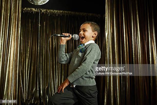 Boy singing on stage