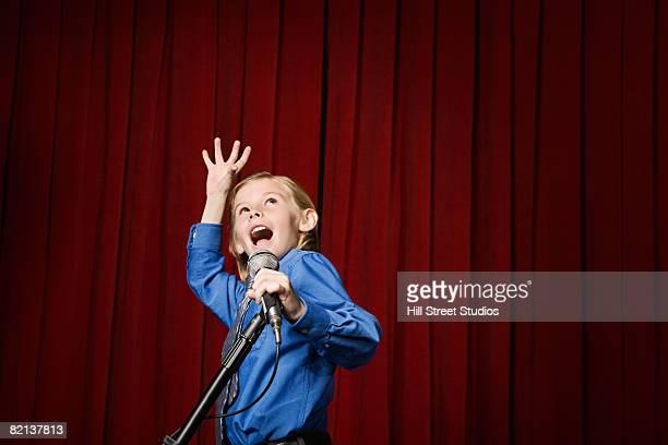 boy singing on stage - winners podium stockfoto's en -beelden