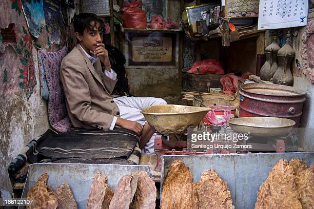 CONTENT] A boy sits in his shop in the old city of Sana'a Yemen Sana'a is one of the oldest continuously inhabited cities in the world