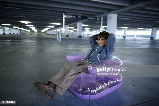 Boy sits in inflatable chair