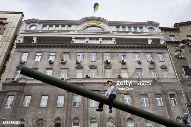 A boy sits on a cannon as Ukraine celebrates Independence Day on August 24 2017 in Kiev Ukraine Ukraine gained independence from the former Soviet...