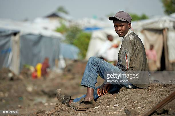 A boy sits on the lava stones in UNHCR camp Mugunga III for displaced persons on January 14 2013 in Goma Democratic Republic of Congo The war in...