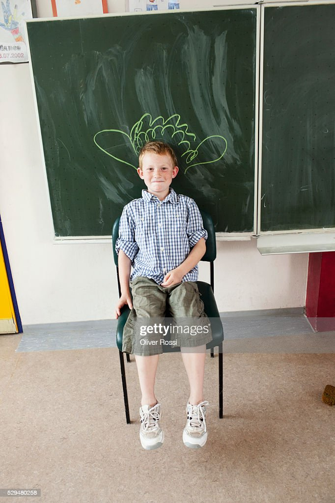 Boy sitting in classroom : Stock Photo