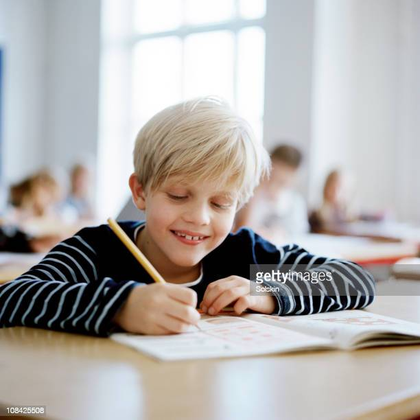 Boy sitting in school class