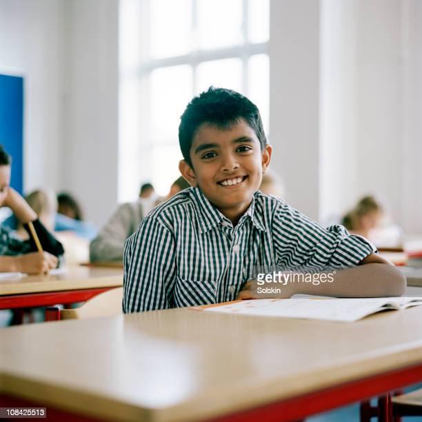 Boy sitting in school class