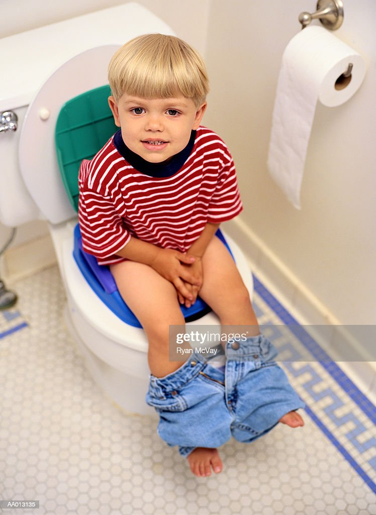 Boy Sitting on a Potty Chair : Stock Photo