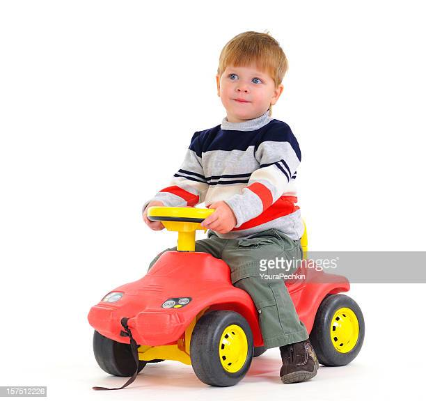 Boy sitting on car