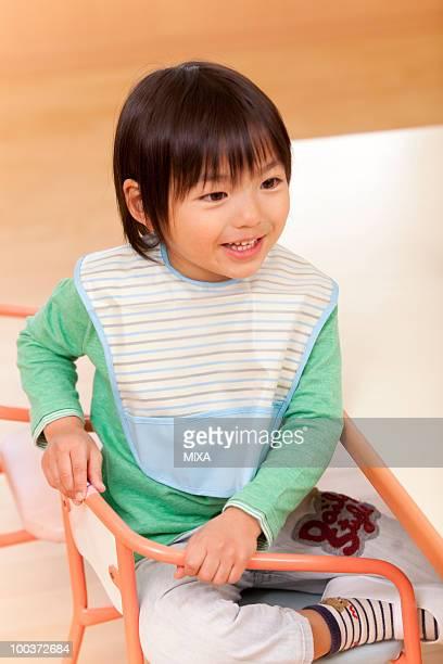 Boy Sitting on Chair
