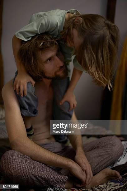 Boy sitting on man's shoulders, indoors