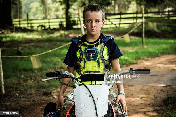 boy (10yrs) sitting on motorcycle