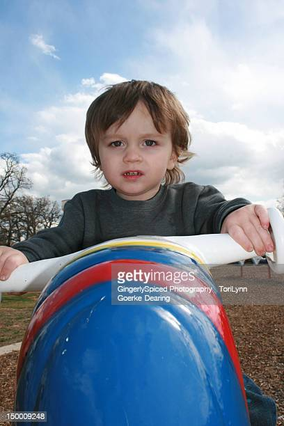 boy sitting on rocket - lynn pleasant stock pictures, royalty-free photos & images