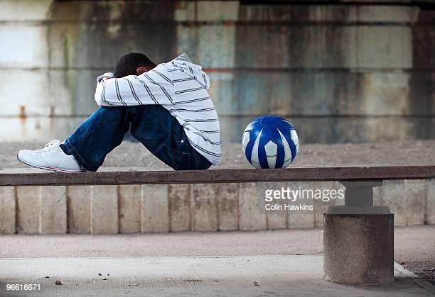 Boy sitting with ball