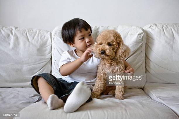 Boy sitting with dog