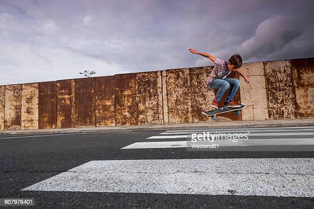 boy skating on a zebra crossing - animated zebra stock pictures, royalty-free photos & images