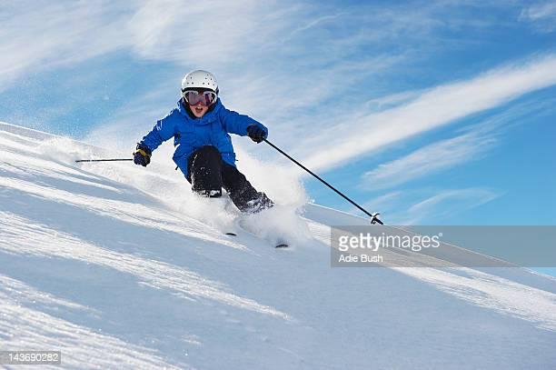 Boy skiing on snowy mountainside