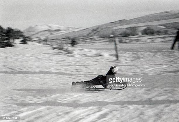 Boy sledding downhill