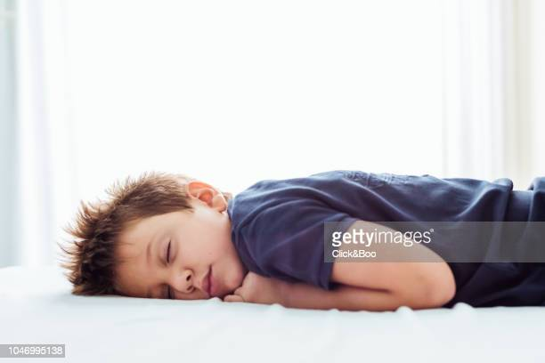 boy sleeping in a bed, with backlit. - 4歳から5歳 ストックフォトと画像