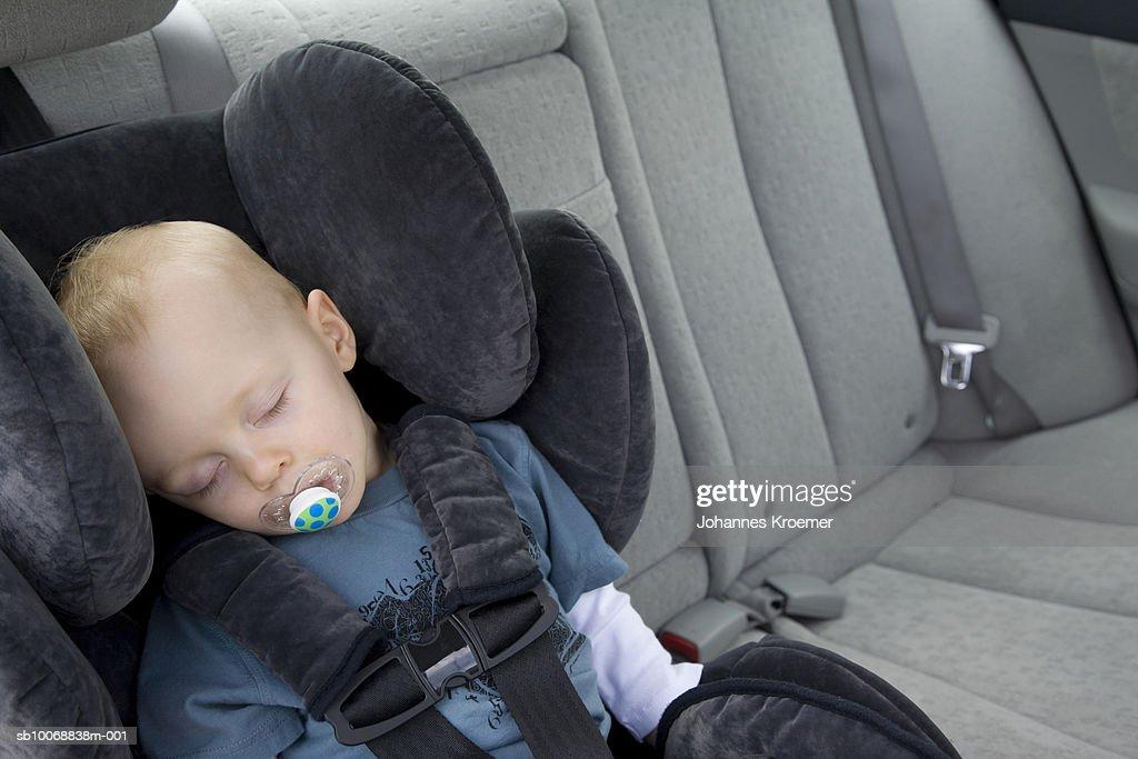 Boy 12 17 Months Sleeping In Car Seat Stock Photo