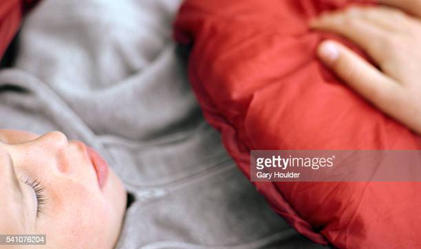 Boy Sleeping in Sleeping Bag