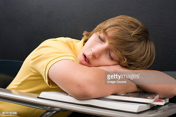A boy sleeping on his desk