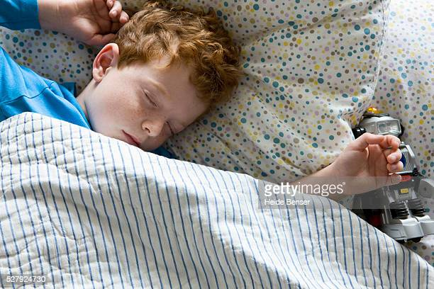 Boy (7-9) sleeping