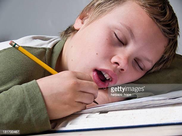 Boy sleeping while studying