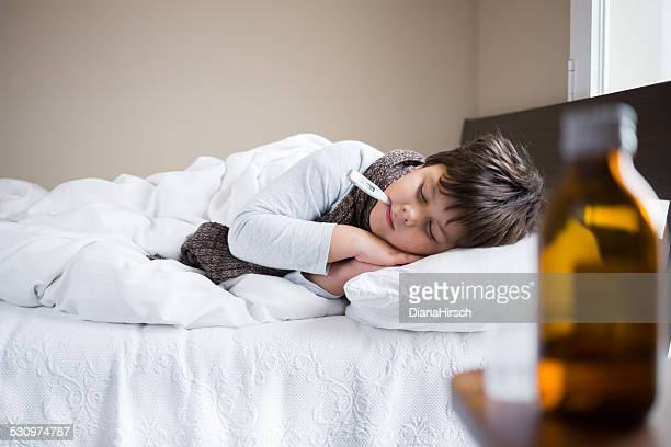 boy sleeping with digital thermometer