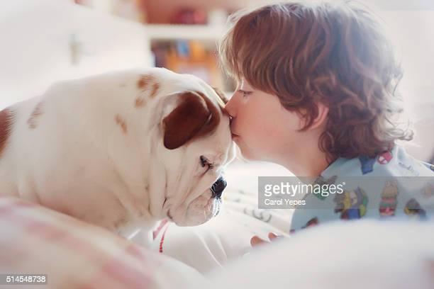 boy sleeping with dog