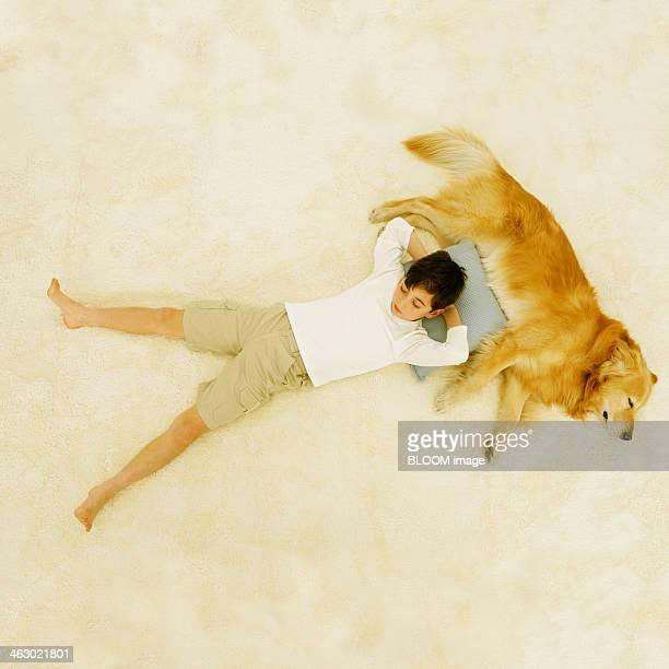 Boy Sleeping With Golden Retriever