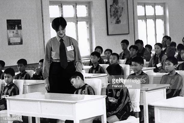A boy sleeps during an Intercampus school class on October 12 2000 in Qingdao China Since 1997 Inter Campus has implemented a flexible and longterm...