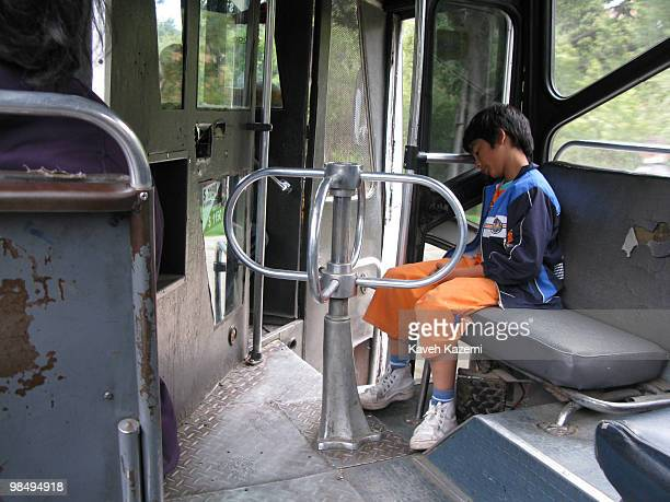 A boy sleeps on a public transport bus in the city Bogota formerly called Santa Fe de Bogota is the capital city of Colombia as well as the most...