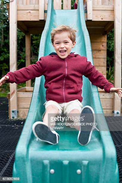 Boy sliding down a slide